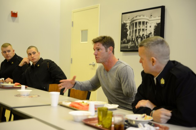 Retired Sgt. Noah Galloway, speaks to Soldiers from the U.S. Army Military District of Washington about overcoming adversity during a luncheon at the Dining Facilities, Joint Base-Myer Henderson Hall, Va., March 7, 2014.