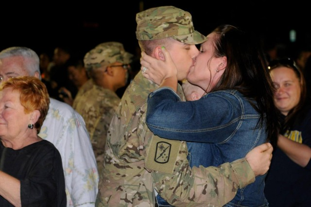 Soldiers from the 524th Combat Sustainment Support Battalion, 45th Sustainment Brigade, 8th Theater Sustainment Command, greet their loved ones during a redeployment ceremony, March 9, after a nine-month deployment in support of Operation Enduring Freedom. (U.S. Army photo by Staff Sgt. Richard Sherba, 8th Military Police Brigade Public Affairs)