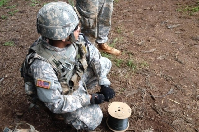 Pfc. Jesus Velez, an engineer with the 95th Engineer Company (Clearance), 84th Engineer Battalion, 130th Engineer Brigade, 8th Theater Sustainment Command, prepares to detonate the Blow in Place charge he placed to clear the range of a simulated Unexploded Ordnance during training at a BIP demolition range, March 5, at Schofield Barracks, Hawaii. (U.S. Army photo by 1st Lt. Connor Kilpatrick, 3rd Platoon, 95th Engineer Company (Clearance), 84th Engineer Battalion, 130th Engineer Brigade, 8th Theater Sustainment Command)