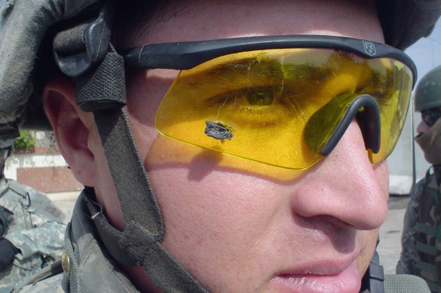 In this Feb. 6, 2006, file photo, 1st Lt. Anthony Aguilar wears the ballistic protective eyewear that prevented a bomb fragment from possibly damaging his eyes when an improvised explosive device detonated near his Stryker vehicle while on patrol in Mosul, Iraq.