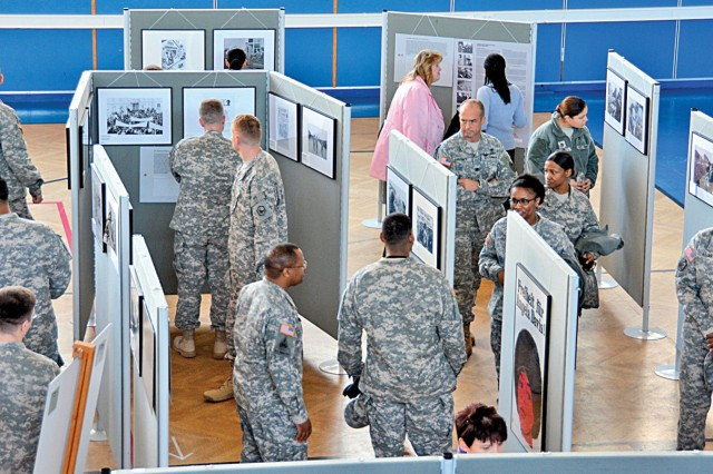 "Community members browse through the ""Breath of Freedom"" photo exhibition during the U.S. Army Garrison Wiesbaden's Black History Month Observance Feb. 24."
