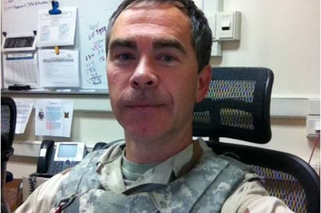 Kenny Light, a human factors engineer in the U.S. Army Research Laboratory, Human Research and Engineering Directorate in Fort Leonard Wood, Mo., sits in his office with body armor on after a mass casualty exercise. Light recently returned from a six-month deployment to Afghanistan.