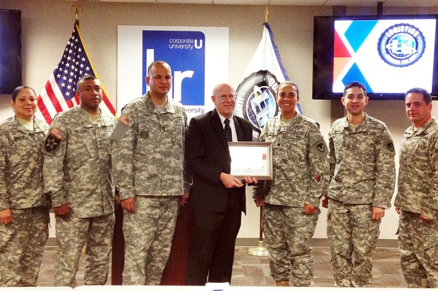 Soldiers from the Brigade Logistics Support Team, which supports the Army Field Support Battalion-Hood, gather for a photo with Bryan Ed, AAFES Distribution Center director, Waco, Texas, Feb. 27. Ed received a certificate of appreciation from Lt. Col. Tosie Andrews, battalion commander. (Photo by AAFES)