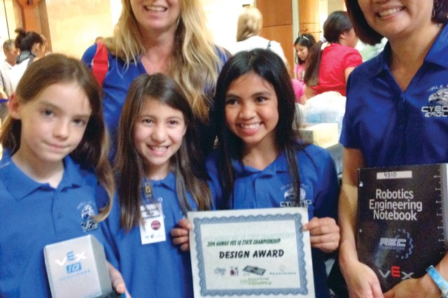"Hale Kula Elementary School students (front, from left) Kennedy Pemberton, Brianna Lebron and Jamie Nena proudly display the design award the ""Cyborg Eagles"" robotics team won at the VEX IQ State Championship at Pearlridge Center Uptown, here, recently. Also at the competition were coaches Tami Sego (back left) and Vera Yamanaka."