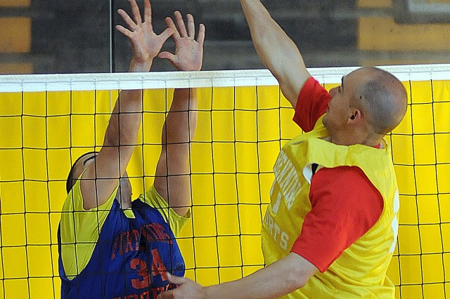Coconut Fever�'s Allen Roura attempts to block a hit from the Bomb Squad Monday during the Commander�'s Cup Preseason Volleyball Tournament at the Smith Fitness Center. Coconut Fever won the best two-out-of-three set match by winning Set 1 21-16 and set 2 21-18.