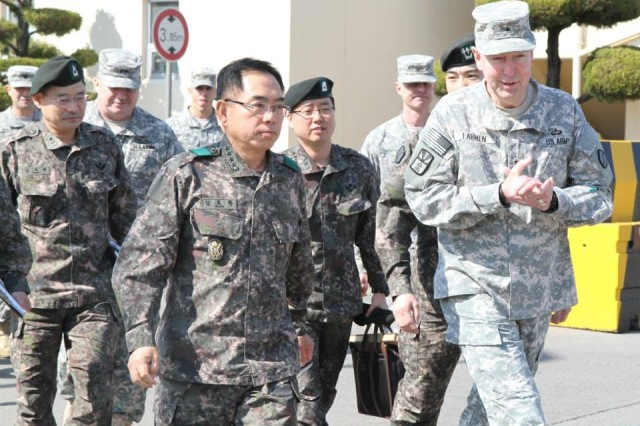 Gen. Kim Yo-hwan, 2nd Operational Command commanding general, visited the 19th Expeditionary Sustainment Command with Brig. Gen. Stephen E. Farmen, 19th ESC commanding general, attending a brief of the Key Resolve/Foal Eagle 2014 exercise on Mar. 5 at Camp Henry.