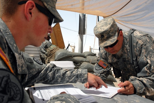 In this file photo, Soldiers overseas register to vote during a unit voting assistance drive.  The 2014 mid-term election season has already started and will continue until Sept. 16, 2014. Although Nov. 4 is election day, mid-September is the deadline for requesting absentee ballots.