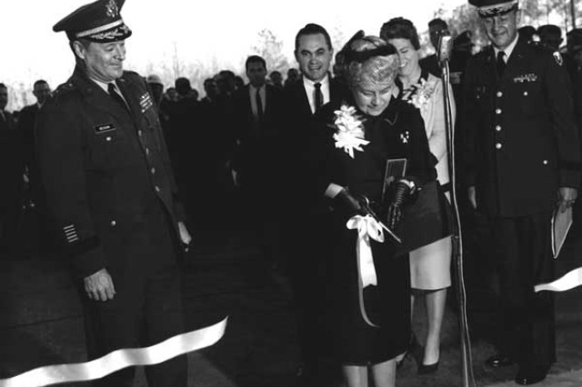 On March 12, 1964, Redstone Arsenal officials were joined by local and state officials, including Gov. George Wallace (in background), to cut the ribbon dedicating the Francis J. McMorrow Missile Laboratories. Today, the building is home to the Aviation and Missile Research Development and Engineering Center.