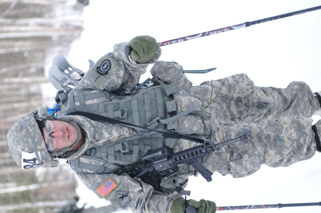 Sgt. David Felix assigned to the 2nd Engineer Brigade is moving out after completing the shooting engagement portion of the Biathlon event. The team, team 68, skied 4km, engaged targets and returned to the starting line. The Biathlon event is one of seven events Soldiers are competing in throughout the week of March 10-13, at the U.S. Army Alaska Winter Game at Fort Wainwright, Alaska. The games will test the Soldiers and the unit�'s ability to execute required cold weather skills and tasks and build esprit de corps with tough, demanding and realistic training. There are 29 teams, each team is comprised of ten Soldiers. The teams are competing in seven different events March 10-13.  March 11, 2014. Fort Wainwright, Alaska. (Photo by Capt. Patrick Sawicki U.S. Army Alaska public affairs)