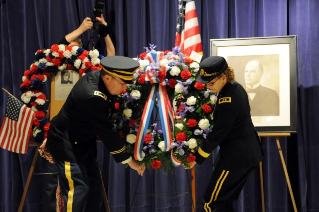 A wreath is placed in memorial to William McKinley by Army Reserve Maj. Gen. Karen LeDoux, commander of the 88th Regional Support Command, and Chaplain (Lt. Col.) Robert Brady, deputy chaplain of the 88th RSC, during a ceremony at his Presidential Library and Museum in Canton, Ohio,  Jan. 25, 2014. A total of six wreaths were ceremonially placed next to a photograph of the assassinated president who was born 171 years ago.  Kim Kenney, curator of the President McKinley Library and Museum, announced those laying wreaths to include Civil War Re-enactors, Masons of McKinley Lodge 431, Department of Ohio Army & Navy Union, Military Order of the Loyal Legion of the United States, and State Senator W. Scott on behalf of the State of Ohio. LeDoux represented the President of the United States and layed the final wreath on his behalf. Twenty-one seconds were then stood in silence followed by the playing of taps by Staff Sgt. Jeff Hotz of the 338th Army Band.