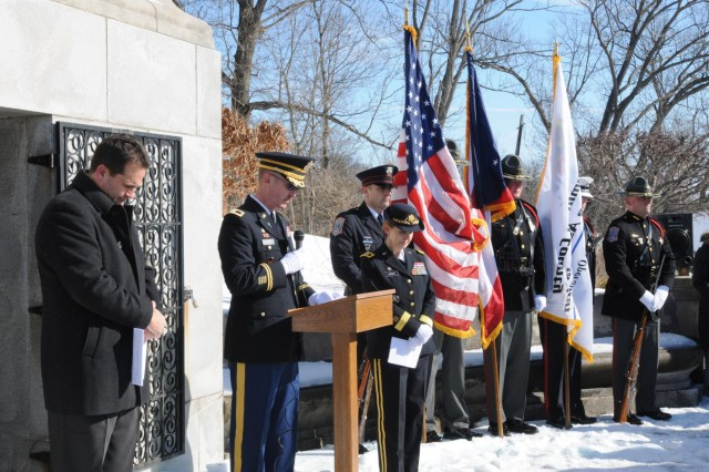 Col. Erik Feig, Army Reserve chaplain, 88th Regional Support Command, conducts an opening prayer in honor of President William Henry during a wreath laying ceremony at his memorial site in North Bend, Ohio, Feb. 7, 2014.