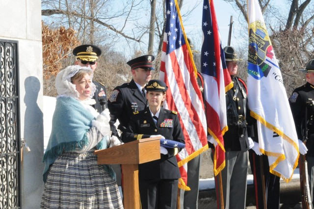 Susan Bell, portraying herself as Anna Symmes-Harrison, gives tribute to her late husband President William Henry Harrison Memorial during a wreath laying ceremony in his honor, North Bend, Ohio, Feb. 7, 2014.