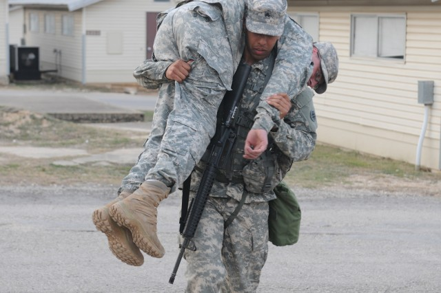 "CAMP BULLIS, Texas �"" Sgt. Damian Robinson, with the 356th Transportation Company in Las Cruces, N.M., conducts a one-man carry during the 4th Sustainment Command (Expeditionary) Best Warrior Competition here Mar. 7."