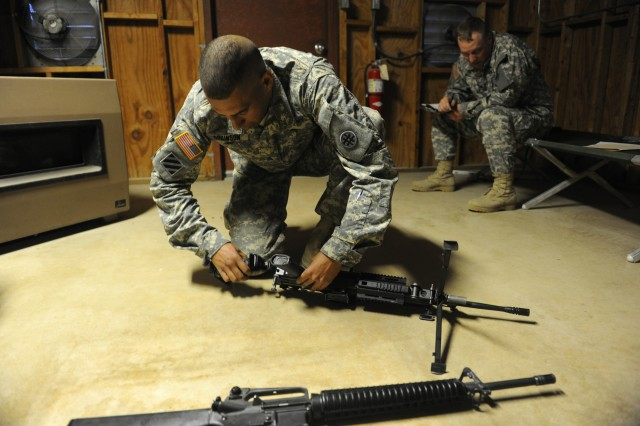 "CAMP BULLIS, Texas �"" Sgt. Damian Robinson, with the 356th Transportation Company in Las Cruces, N.M., is evaluated as he assembles weapons during the 4th Sustainment Command (Expeditionary) Best Warrior Competition here Mar. 7."