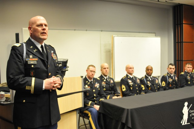 Col. Paul Kreis, Commander of the 158th Infantry Brigade opens the panel discussions attended by Soldiers of the Brigade. (U.S. Army Photo by Sgt. Brad Miller)