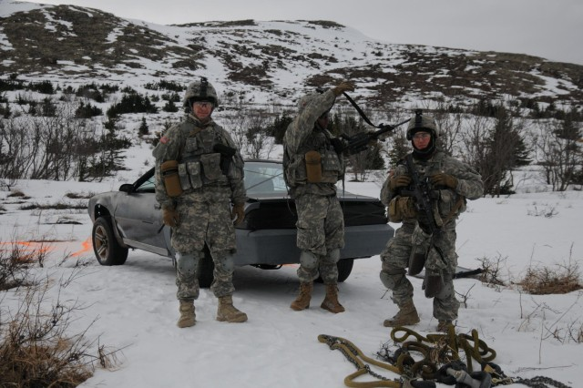 U.S. Army paratroopers with Hatchet Company, 1st Battalion, 501st Infantry Regiment, 4th Infantry Brigade Combat Team (Airborne), 25th Infantry Division, stand by consolidated sling load equipment that was used to transport a stripped down 1989 Camaro, pictured, to its area target location March 4, 2014, at Joint Base Elmendorf-Richardson, Alaska. The paratroopers conducted aerial platform training using the Camaro as an area target. (U.S. Army photo by Staff Sgt. Jeffrey Smith/Released)