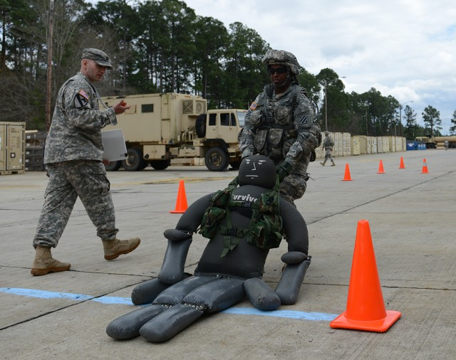 Soldiers complete combat tasks for Army Physical Demands Study