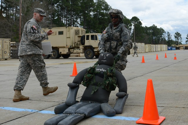 Cpl. Jacqueline Beachum drags a 270-pound dummy for 15 meters during the Army Physical Demands Study, at Fort Stewart, Ga., March 12, 2014.