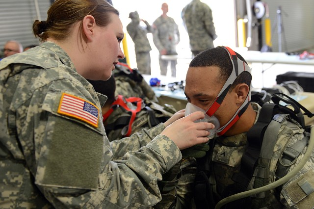 Pvt. Roger Davis is fitted with an oxygen mask so technicians can track his breathing in the Army Physical Demands Study, at Fort Stewart, Ga., March 12, 2014.