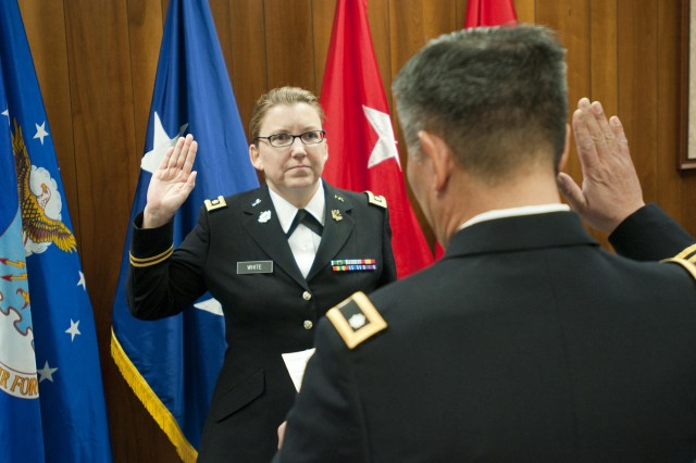 Maj. Angela White is sworn in as only the second female chaplain for the Kentucky National Guard by Lt. Col. Yong Cho during an appointment ceremony in Frankfort, Ky., Feb. 21, 2014. (U.S. Army National Guard photo by Staff Sgt. Scott Raymond)