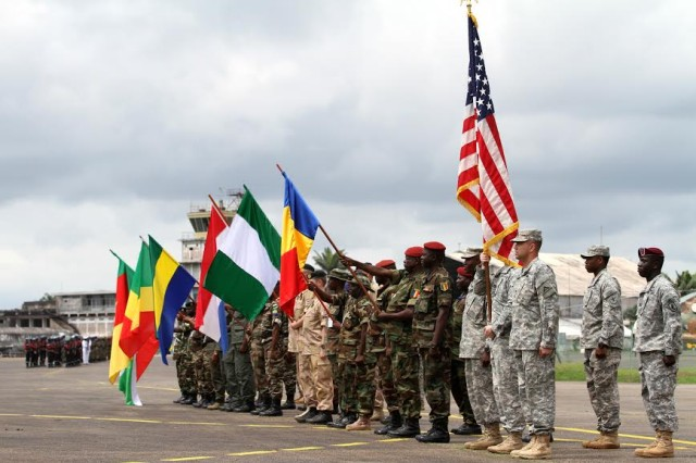 Military Representatives from the countries of Burundi, Cameroon, Republic of Congo, Gabon, Netherlands, Nigeria, Chad and the United States participate in the opening ceremony for Central Accord 14 at the 102 Air Force Base airfield in Douala Cameroon, March 11. The U.S. is working with Host Nation and Partner Nations in order to conduct familiarization in peacekeeping operations, humanitarian disaster response and combating terrorism for a stable and secure Africa.