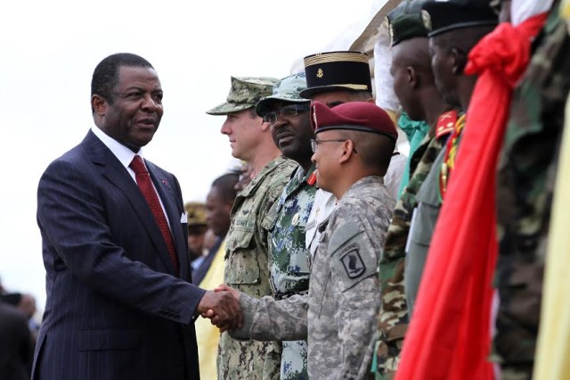 Cameroon Minister of Defense Edgar Alain Mebengo shakes hands with partner nation military representatives during the opening ceremony for Central Accord 14 at the 102 Air Force Base airfield in Douala Cameroon, March 11. By participating in Central Accord 14, the U.S. military is getting valuable training as well, in areas such as logistics, aero-medical operations, combined command, and expeditionary operations.