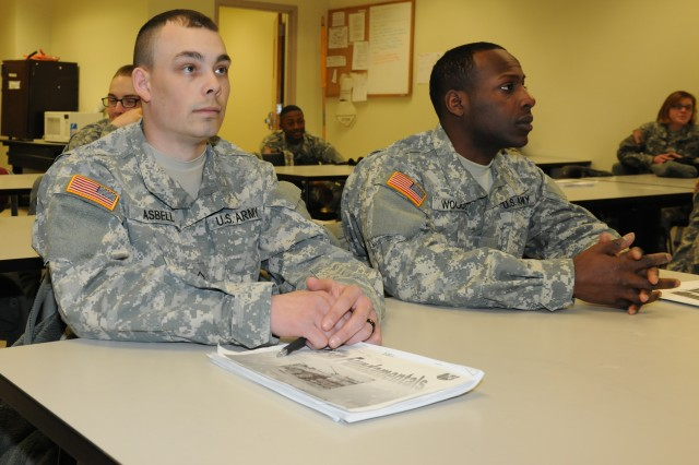 Pfc. Ozzy Asbell,left, Company B, 84th Chemical Battalion, 3rd Chemical Brigade, attends Mass Casualty Decontamination Class along with Pvt. Tyreek Woods.