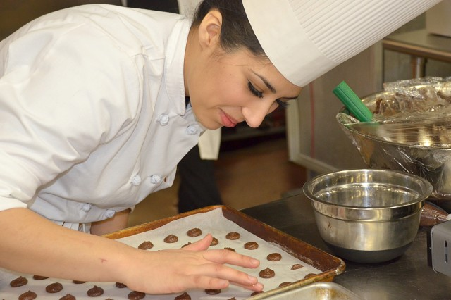 Spc. Alejandra Garcia, representing the Fort Hood, Texas, team, works on the chocolate macaroons used in the team�'s dessert during the Military Hot Food Kitchen category of the 39th Annual Military Culinary Arts Competitive Training Event held at Fort Lee March 9-13.
