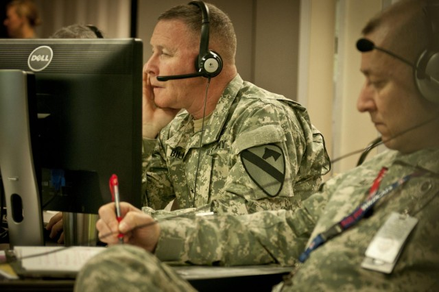 First Cavalry Division Commander Brig. Gen. Michael Bills conducts the battle update briefing during a command post exercise March 14, 2014. CPX's are training events for command staffs in which they set up a joint operations center and respond to realistic notional events just like they would down range, with observers and advisers helping them fine-tune their tasks, techniques and procedures. The 1st Cav. Div. conducted the exercise to prepare for its upcoming deployment to Afghanistan. (U.S. Army photo by Sgt. Ken Scar, 7th Mobile Public Affairs Detachment)