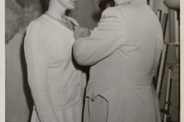 General William Donovan presents Miss Virginia Hall with the Distinguished Service Cross, September 1945.  President Harry Truman wanted to make the presentation, but Hall opted for a private ceremony in Donovan�'s office to preserve her cover as a secret agent.