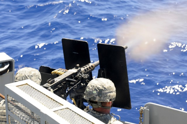 JOINT BASE PEARL HARBOR-HICKAM, Hawaii - An M2 .50 Cal machine gun team from the 163rd Transportation Detachment, 545th Transportation Company, 45th Special Troops Battalion, 8th Military Police Brigade, 8th Theater Sustainment Command, engages targets from the U.S. Army Vessel CW3 Harold C. Clinger (LSV-2) during a live-fire waterborne gunnery exercise at the naval wet range site in the Pacific Ocean, March 14. (Photo by Staff Sgt. Richard Sherba, 8th Military Police Brigade Public Affairs, 8th Theater Sustainment Command)
