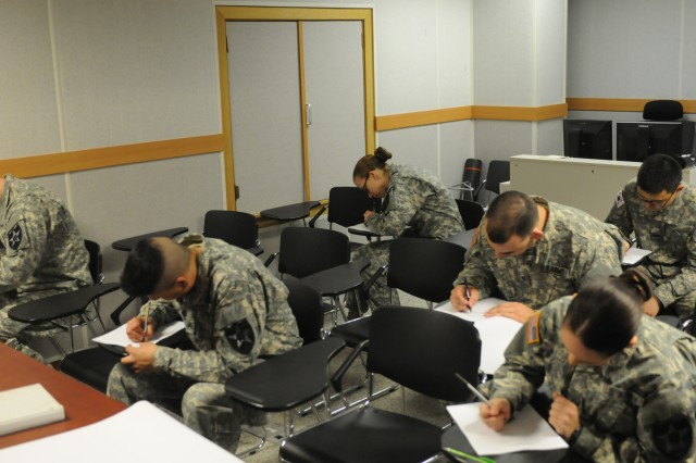 "CAMP CASEY, South Korea - Soldiers from 210th Field Artillery Brigade, 2nd Infantry Division take a written exam as part of the Best Warrior Competition on Camp Casey, South Korea March 18, 2014. The Best Warrior competition is a four day event where Soldiers are tested physically, mentally, and in the areas of land navigation, warrior tasks and battle drills, and a formal board. This event showcases Soldiers and demonstrates 210th FA Bde.""Fight Tonight"" spirit. (U.S. Army photos by Pfc. Song Gun-woo 210th Field Artillery Brigade Public Affairs/Released)."