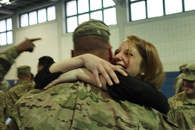 Caroline Schaeffer embraces her husband, Capt. Zak Schaeffer, 2nd Squadron, 2nd Cavalry Regiment, during a redeployment ceremony, Jan. 21.