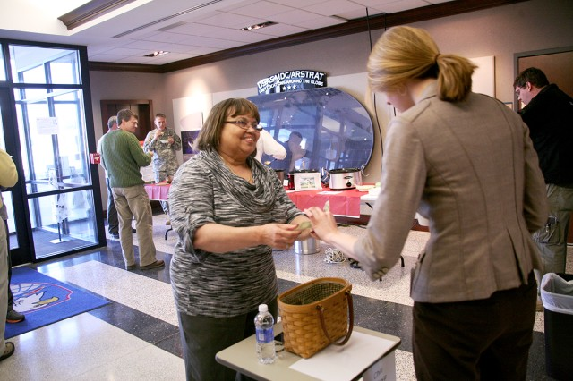 Joanna Brunson, program support specialist, Technical Center, U.S. Army Space and Missile Defense Command/Army Forces Strategic Command, collects donations during the command's recent Chili Cookoff to benefit the Army Emergency Relief fund.