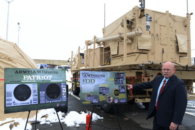 J. Michael Achord, deputy project manager, Integrated Air and Missile Defense Project Office, Redstone Arsenal, Ala., stands in front of the engagement operation center and the integrated collaborative environment outside the Pentagon.