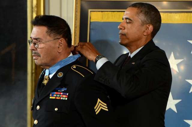 President Barack Obama awards the Medal of Honor to Sgt. Santiago J. Erevia during a ceremony at the White House, March 18, 2014, in Washington, D.C. Erevia earned the Medal of Honor for his courageous actions while serving as radio telephone operator during a search-and-clear mission near Tam Ky, Republic of Vietnam, May 21, 1969.