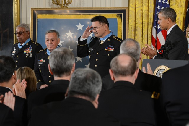 President Barack Obama applauds the newest living recipients of the Medal of Honor during a ceremony at the White House in Washington, D.C., March 18, 2014. From left are Sgt. 1st Class Melvin Morris, Master Sgt. Jose Rodela and Sgt. Santiago J. Erevia.