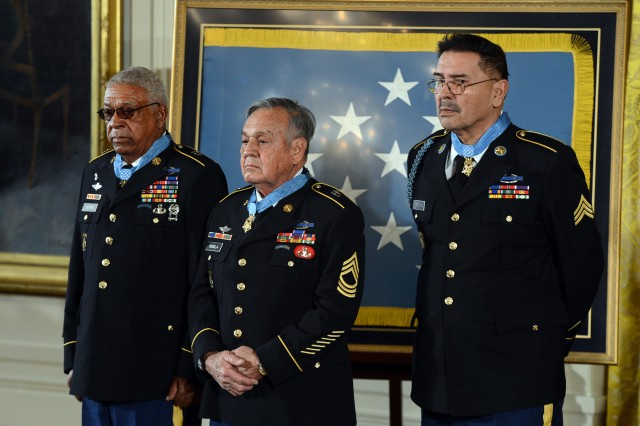 The newest living recipients of the Medal of Honor stand during a ceremony at the White House in Washington, D.C., March 18, 2014. From left are Sgt. 1st  Class Melvin Morris, Master Sgt. Jose Rodela and Sgt. Santiago J. Erevia.