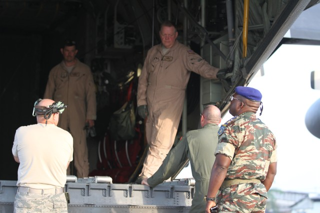 U.S. Air Force Chief Master Sgt. Robert J. Shalz, 139th Airlift Wing, loadmaster, teaches Cameroon Defense Force service members how to load crates on a C-130 using a forklift during Central Accord 14 at the 102 Air Force Base airfield in Douala Cameroon, March 13. The U.S. is working with Host Nation and Partner Nations in order to conduct familiarization in peacekeeping operations, humanitarian disaster response and combating terrorism for a stable and secure Africa.