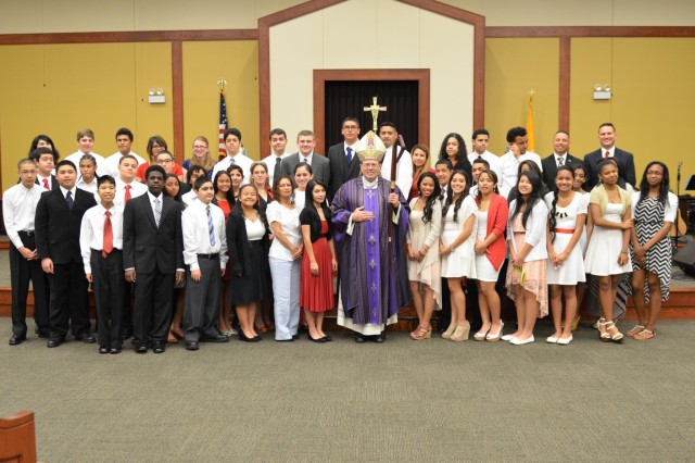 Bishop, Neal Buckon, the Archdiocese for the Military Services, USA, stands with members of the Catholic Church who desire to receive the Confirmation of their faith, prior to a sacrament of Confirmation March 15 at the Spirit of Fort Hood Chapel. Bishop Buckon offers this service to military members and their families in more than 90 locations across the world.