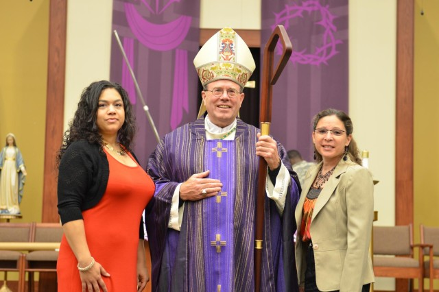 Monica Gonzalez (left) and her sponsor, Rose McDowell (right) pose for a photo with Bishop Neal Buckon, the Archdiocese for the Military Services, USA, prior to a sacrament of Confirmation March 15 at the Spirit of Fort Hood Chapel. Gonzalez, a former soldier, is reconfirming her faith as an adult as a personal goal she set for herself after her last deployment.