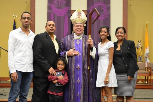 Amlis Robledo and her family pose with a photo with Bishop Neal Buckon, the Archdiocese for the Military Services, USA, prior to a sacrament of Confirmation March 15 at the Spirit of Fort Hood Chapel. Robledo will confirm her faith, which signifies her first step into adulthood.