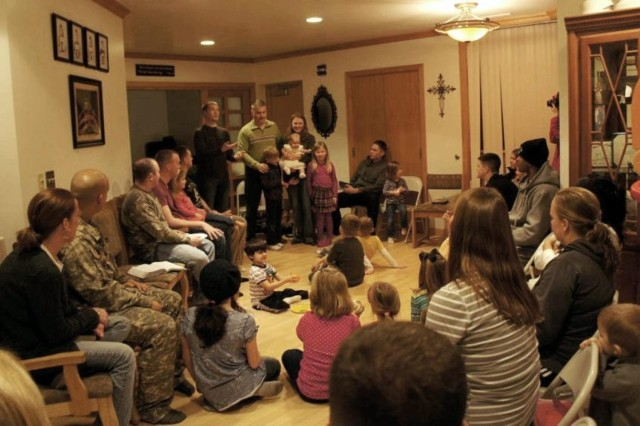 Sgt. Peter Adams, a quartermaster and chemical equipment repairer with Headquarters and Support Company, 602nd Aviation Support Battalion, 2nd Combat Aviation Brigade, 2nd Infantry Division, conducts a bible study at his home April 18, at Camp Humphreys, South Korea. (Photo Courtesy of Breanna Adams)