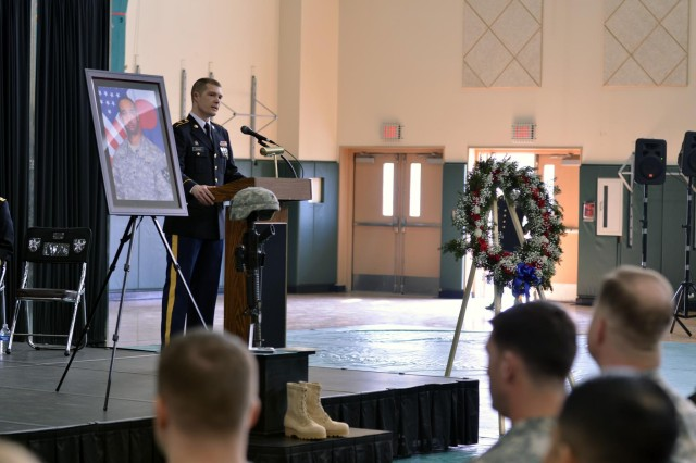 Sgt. Peter Adams, a quartermaster and chemical equipment repairer with Headquarters and Support Company, 602nd Aviation Support Battalion, 2nd Combat Aviation Brigade, 2nd Infantry Division, conducts a memorial ceremony Feb. 28, at Camp Humphreys, South Korea.