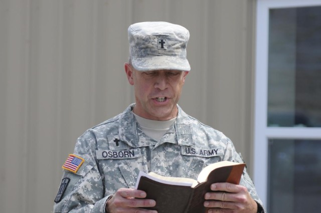 Capt. Roger Osborn, chaplain with the Joint Task Force, Guantanamo, reads  a scripture at the ribbon cutting and dedication ceremony of the new Trooper Chapel. (U.S. Army Photo by Pvt. Kourtney Grimes/ Released)