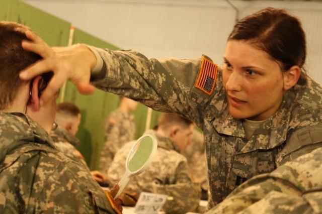 Capt Noetzel assists Soldier with TCAPS