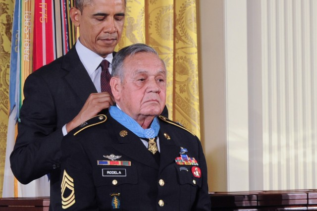 President Barack Obama awards the Medal of Honor to Master Sgt. Jose Rodela during a ceremony at the White House, March 18, 2014, in Washington, D.C. Rodela earned the Medal of Honor for his valorous actions during combat operations against an armed enemy in Phuoc Long Province, Republic of Vietnam, Sept. 1, 1969.