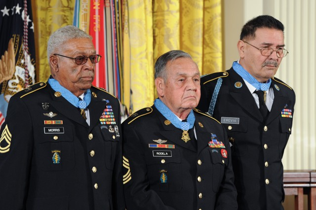 Sgt. 1st Class Melvin Morris, Master Sgt. Jose Rodela, and Sgt. Santiago J. Erevia, along with 21 other veterans from World War II, the Korean War, and the Vietnam War, had their Distinguished Service Cross medals upgraded to Medals of Honor. Here, they take part in a Medal of Honor presentation ceremony at the White House, March 18, 2014. Of the 24 who fought in World War II, Korea and Vietnam, only Morris, Rodela and Erevia are living, who are all from the Vietnam War.
