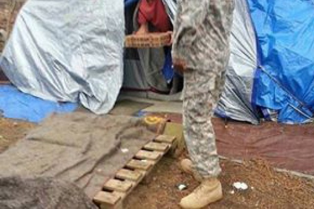 This picture of an anonymous First Army Soldier giving pizza to the homeless was posted to social media March 3, 2014, and immediately widely shared, generating thousands of hits and hundreds of positive comments in just a couple of days. It was later discovered the Soldier in the picture is Cpl. Derno McCary, an observer-coach/trainer with 2-312th Regiment, 174th Infantry Brigade, Division East, at Joint Base McGuire-Dix-Lakehurst, N.J. The photo was taken by another 2-312th observer-coach/trainer, Sgt. Richard Saenz, when the two Soldiers volunteered their off-duty time to hand out dozens of pizzas to homeless people in Camden, N.J., March 2. Saenz posted the photo online not for personal recognition, he said, but hoping to inspire others to help the needy in their communities.