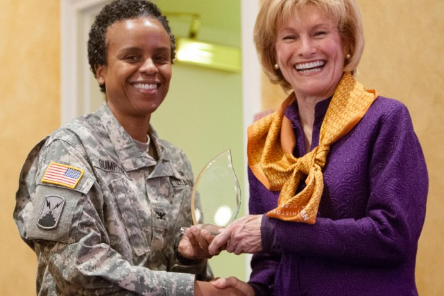 """Col. Fern O. Sumpter, Joint Base Myer-Henderson Hall commander, thanks Joan Wages, founding board member of the National Women's History Museum, for being the guest speaker at JBM-HH's celebration of Women's History Month March 12, 2014, at the Fort Myer Officers Club. This year's Women's History Month theme is """"celebrating women of character, courage and commitment."""""""